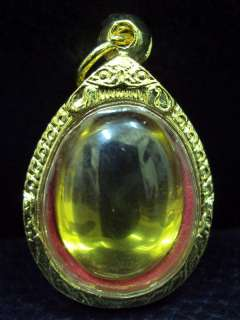 Yellow Naga eye Gem in Gold Case Blessed High Powerful Thai Amulet