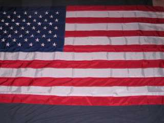 THIS EXTREMELY LARGE FLAG IS 10X15 FEET. IT IS MADE OF NYLON WITH