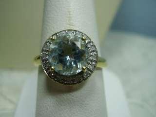 Beautiful 10K Yellow Gold Swiss Blue Topaz and Diamond Ring
