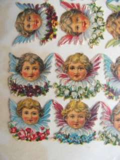 vintage diecut paper scrap tiny FLYING ANGEL FACES victorian floral