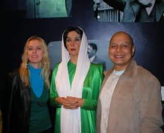 My husband and I at Madame Tussauds in London, with Benazir Bhuttos